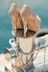 Wedding shoes on the bollard in yacht club
