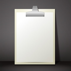 Blank white paper sheet in a clipboard of standing on the table