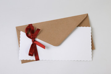 Christmas envelope with red ribbon