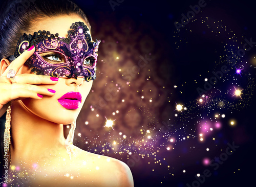 canvas print picture Sexy woman wearing carnival mask over holiday dark background