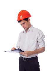Man in a shirt orange construction helmet writes black folder