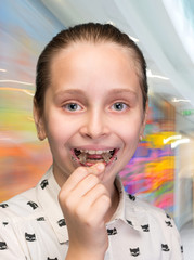 Happy girl holding braces