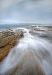 Misty fog and ocean chasm flows