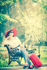 Young beautiful woman in a red hat