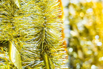 Golden Christmas tinsel with a ribbons