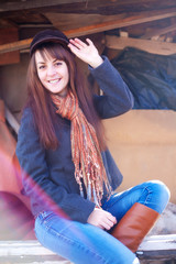 Cheerful girl in a cap