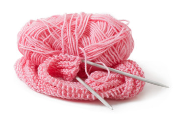 pink yarn for knitting isolated on white background