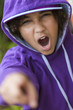 African American Girl in Hoodie & Baseball Cap Shouting