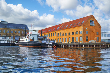 The moored ship near quaysidenear with red roof house in Copenha