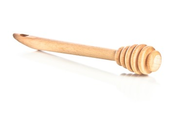 wooden honey dipper isolated