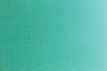 green tile texture of swimming pool