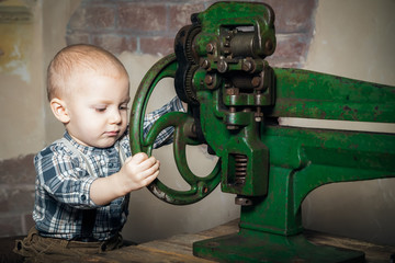 boy turning the machine's wheel