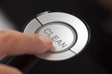 Woman's finger pressing the button Clean