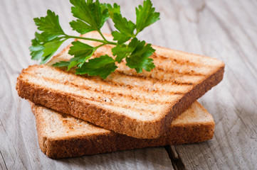 toasts with parsley on the old table