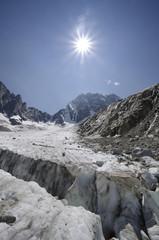 Alpine landscape with glacier crevasse and mountains