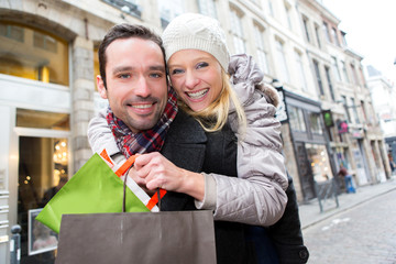 Young attractive couple having fun while shopping