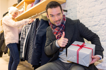 Young attrative man preparing gift surprise