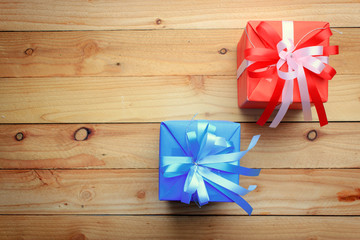 Red and blue gift box for new year on wooden background