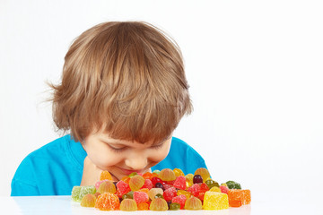 Boy with jelly candies on a white background