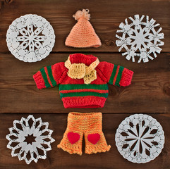 set of warm knitted clothes for dolls