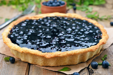 Blueberry pie on rustic table