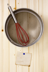 Sieve on a wooden wall