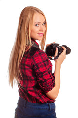 Woman photographer turn around while shooting - isolated on whit