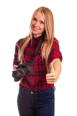 Portrait of a female photographer gesturing thumbs up over white