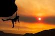 Climber rappells the edge.