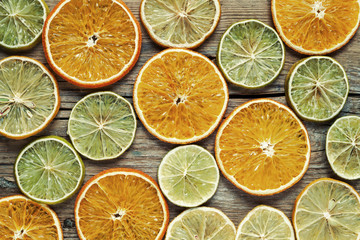 Dried orange and lemon slices on wooden table.