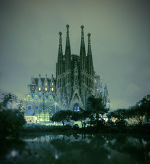 La Sagrada Familia cathedral view from the pond at night