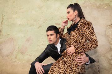 Beautiful fashion woman sitting on her boyfriend's lap