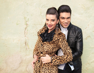 Cute fashion couple embracing