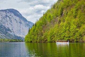 Tourist boat at alpine mountain