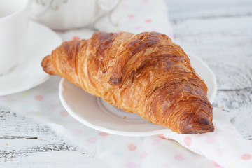 Fresh croissant on a table