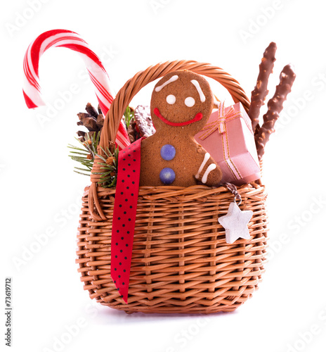 Christmas gift basket with treats and gingerbread man isolated - 73619712
