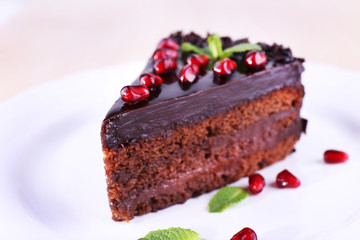 Delicious chocolate cake decorated with pomegranate seeds