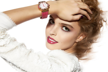 Beautiful girl with evening makeup red lips and watch