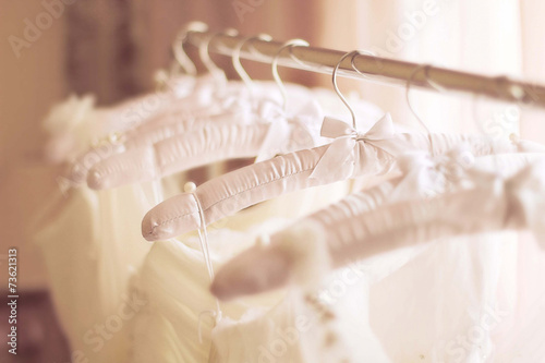 Beautiful white wedding dresses made of silk on hangers