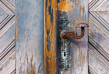 Iron door handle on the old wooden door
