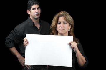 Woman and man holding a white banner isolated on black