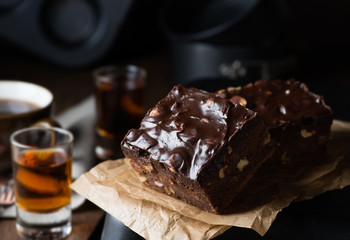 Homemade chocolate brownies with nuts and ganache