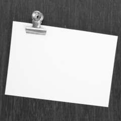 Blank white paper note with metal clip