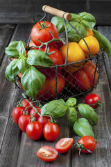 Sweet ripe tomatoes on wooden table