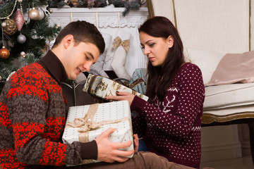 Sitting Young Partners Holding Christmas Presents