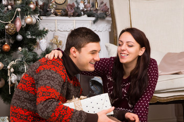 Happy Couple Laughing Near the Christmas Tree