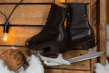 Black Ice Skates Hanging on the Wall