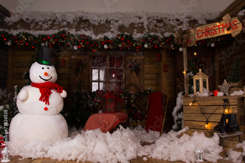 Attractive Christmas Decors Inside a Wooden House - 73626538