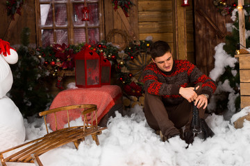 Man Holding Skates Surrounded by Christmas Decors