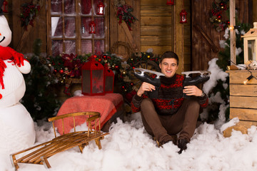 Man Showing Skates at Christmas Decorated House